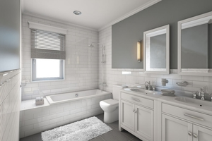 Stunning white tone bathroom remodeling with a minimalistic style and natural light