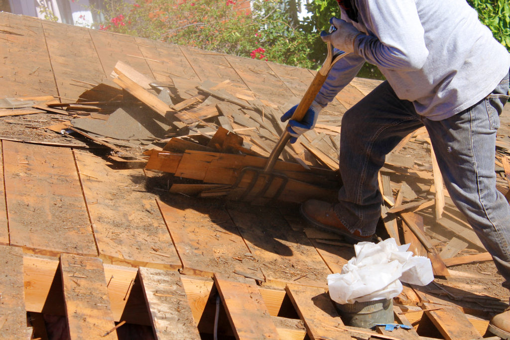 Demolition and removal of old asphalt roof In West Hollywood, CA