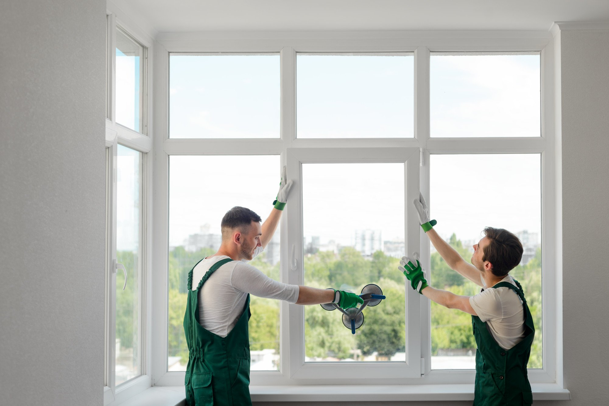 2 builders working and replacing windows for a house in Los Angeles, CA